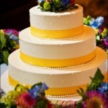 3 tier cake with yellow ribbon