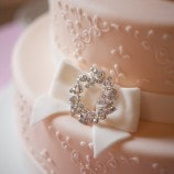 pink wedding cake with white bow