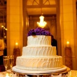 butter cream cake with purple flowers