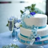 small wedding cake with blue flowers