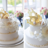 white wedding cake with choclate fish