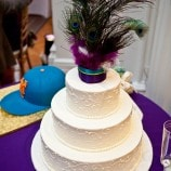 peacock topper on wedding cake