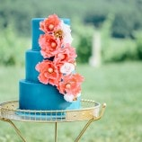 blue cake with orange flowers