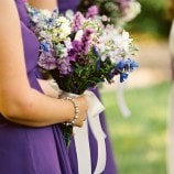 purple bridesmaids dresses at river farm