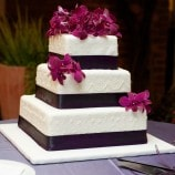 square cake with purple ribbon