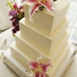 square wedding cake with hibiscus