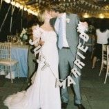 "Under the tent with ""Just Married"" sign"